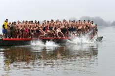 Members of the Serbian Armed Forces swimming for the Holy Epiphany Cross across Serbia