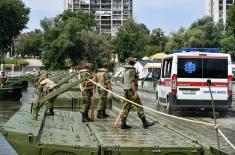 Over pontoon bridge of the Serbian Armed Forces securely and safely to the Lido beach