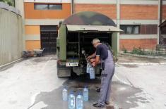 Војска Србије и данас поправља оштећене путеве и водоводе у поплављеним подручјима