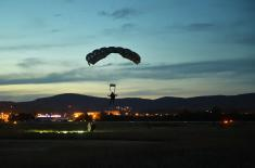 Members of the 63rd Parachute Brigade perform a night jump from 4,500 m
